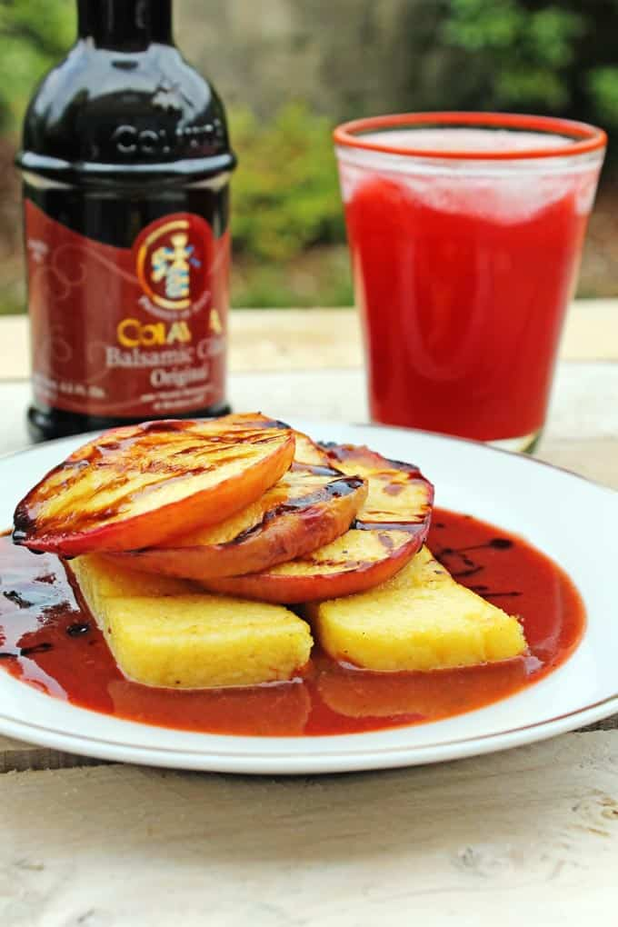 Grilled polenta with peaches, peppery strawberry balsamic sauce, and a raspberry shrub