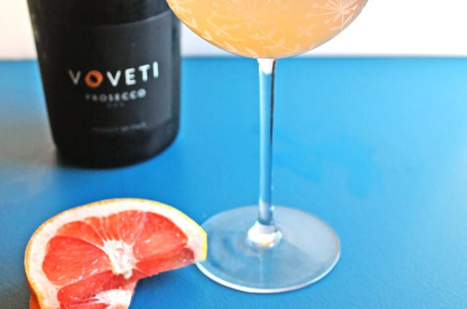 A sweet and tart twist on the classic mimosa with Voveti Prosecco! This honey grapefruit prosecco mimosa is easy to make, and totally delicious!