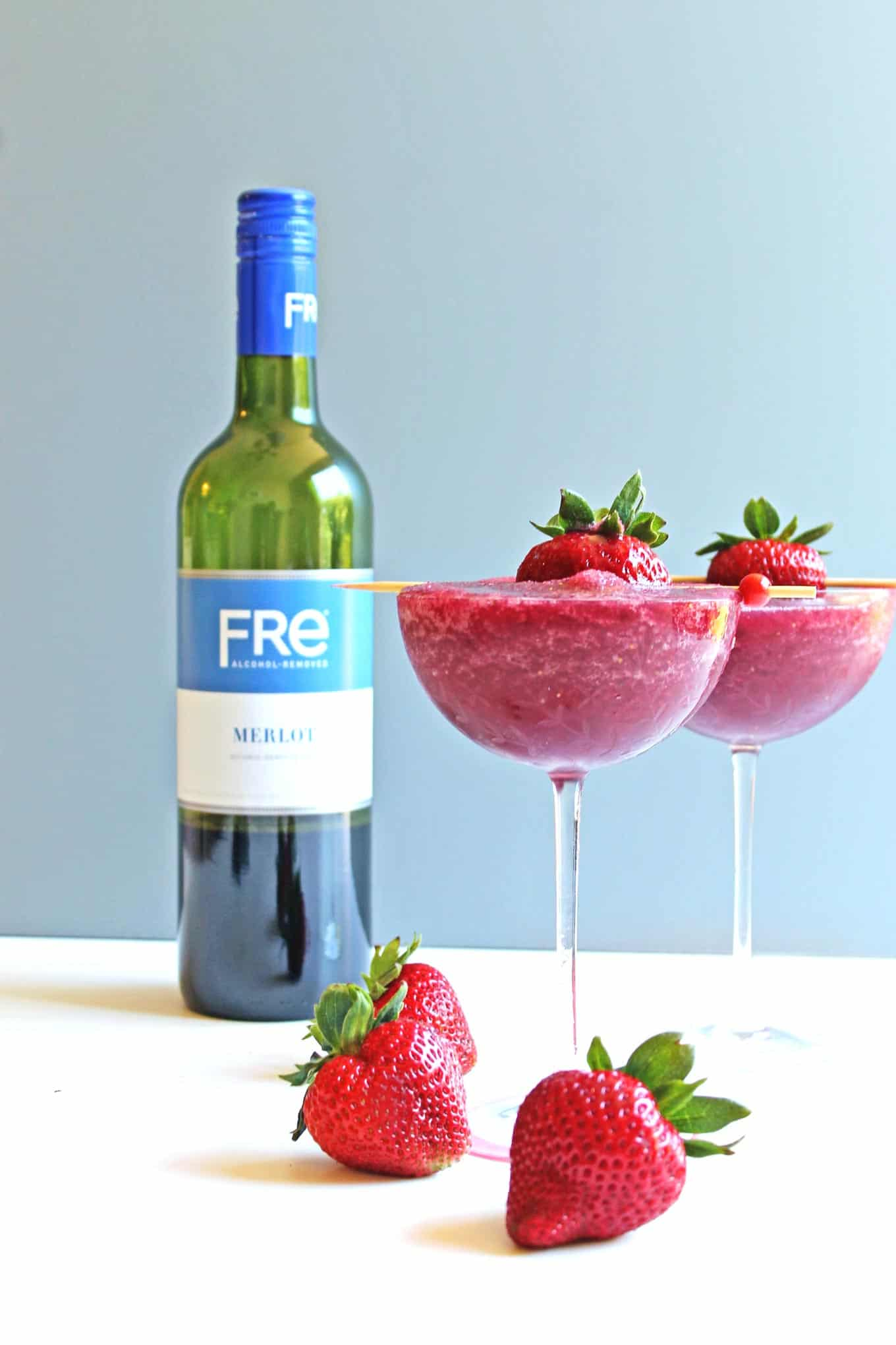 Strawberry merlot slushy mocktail recipe! Yes, you CAN enjoy wine during your pregnancy! This frozen mocktail is a blend of FRE alcohol removed wine and delicious strawberries. The perfect treat for pregnant or alcohol free wine lovers!