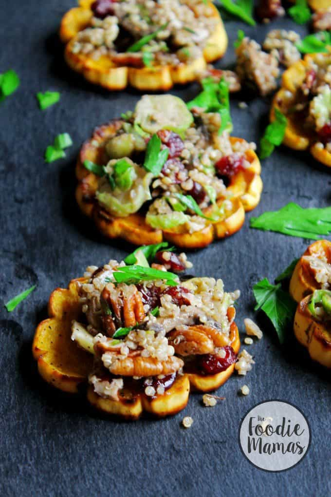 Quinoa stuffed delicata squash rings with mushrooms, cranberries, and pecans + 14 amazing holiday side dishes! Amazing holiday side dish recipes from your favorite food bloggers, The Foodie Mamas!