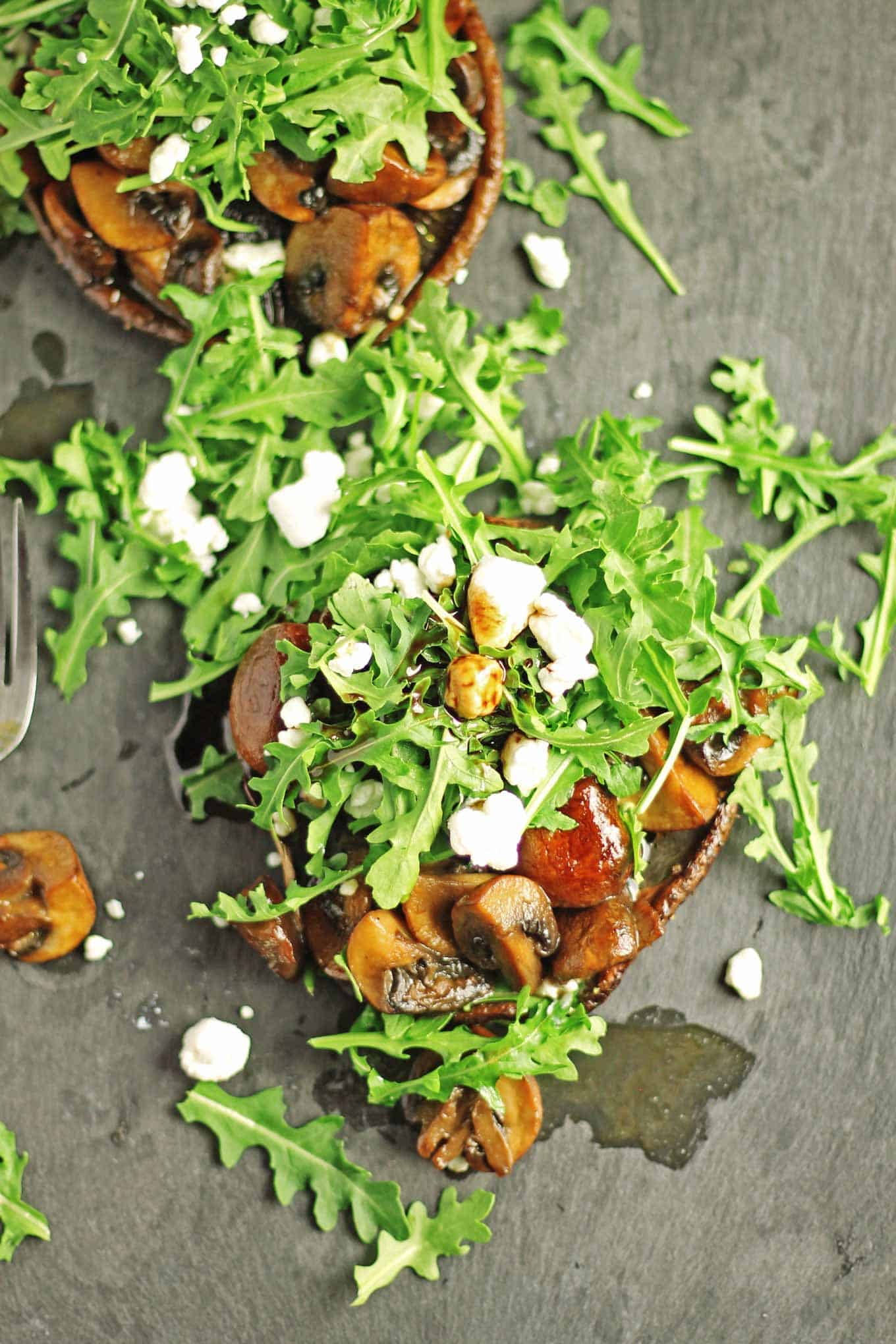 Stacked ale mushrooms with arugula and goat cheese recipe! This 2-mushroom vegetarian dish is sure to please that beer lover in your life. SO GOOD! // Rhubarbarians