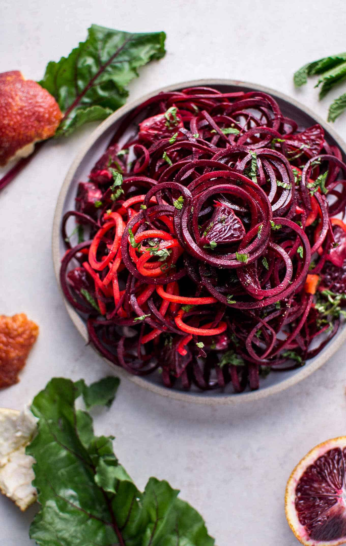 Spiralized raw beet salad with blood oranges + 15 Farmers market recipes to make in March! Delicious, vegetarian, late winter/ early spring, (mostly) healthy recipes made with fresh, seasonal produce from your local farmers market or CSA bin. Eat local!