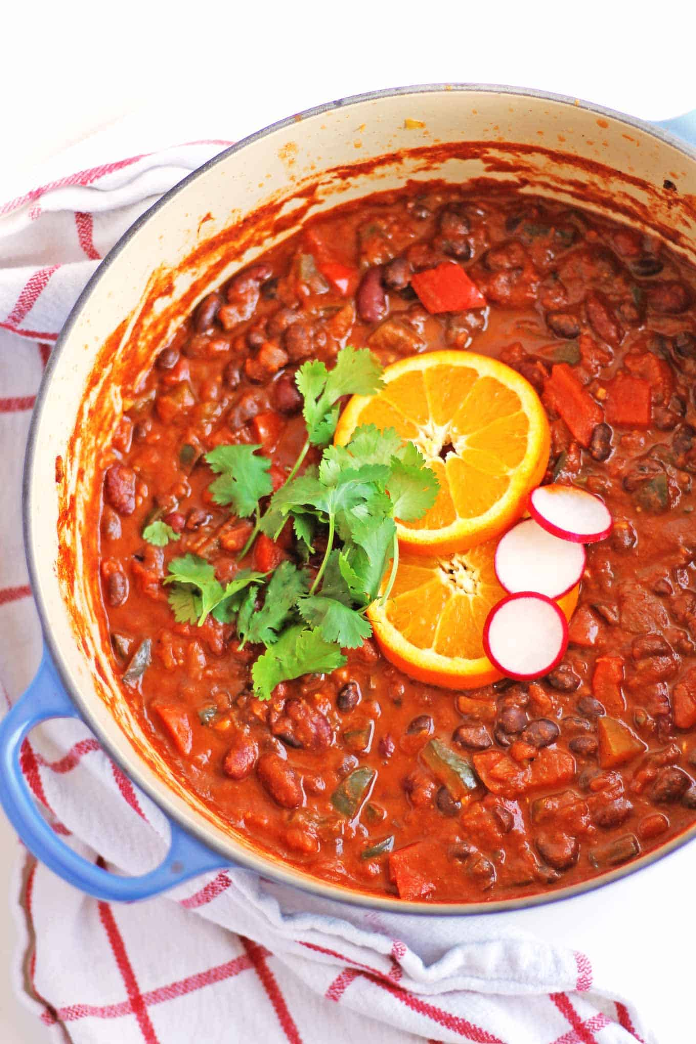 Spicy bean chili with orange and cinnamon recipe! A cozy, vegan chili brightened up with a touch of orange and a pinch of cinnamon. SUPER GOOD! // Rhubarbarians