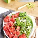 watermelon feta mint salad in a white bowl with a gray napkin