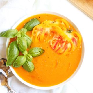 fresh yellow tomato soup with basil