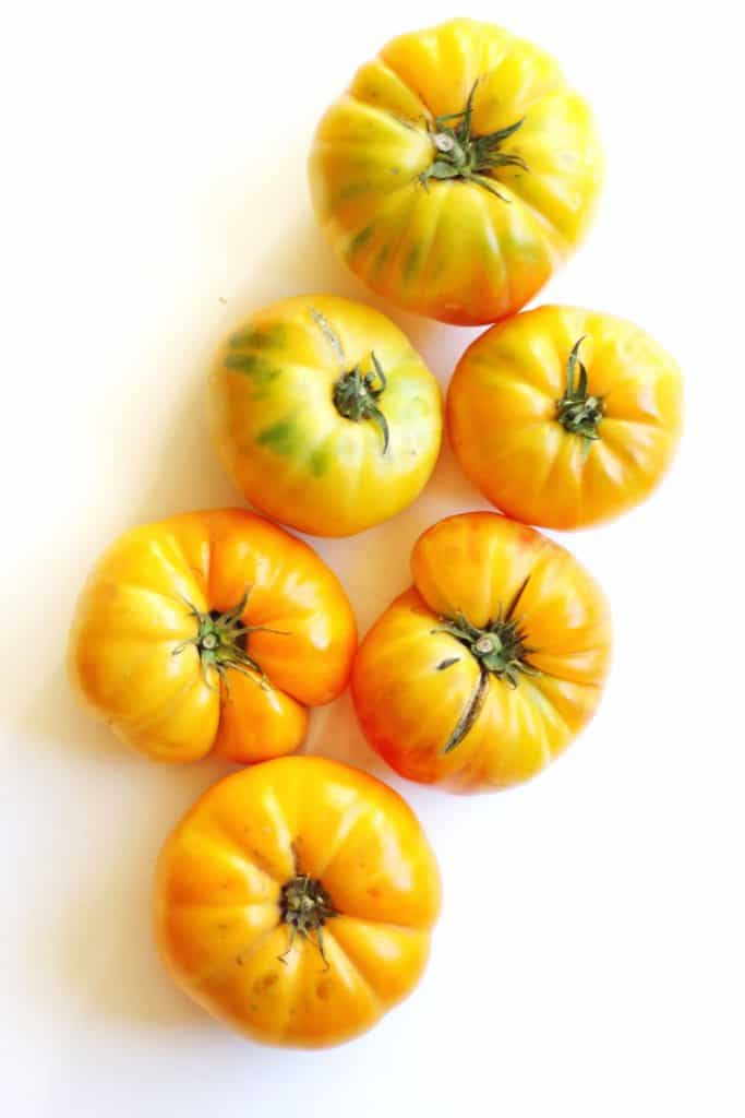 Whole yellow heirloom tomatoes