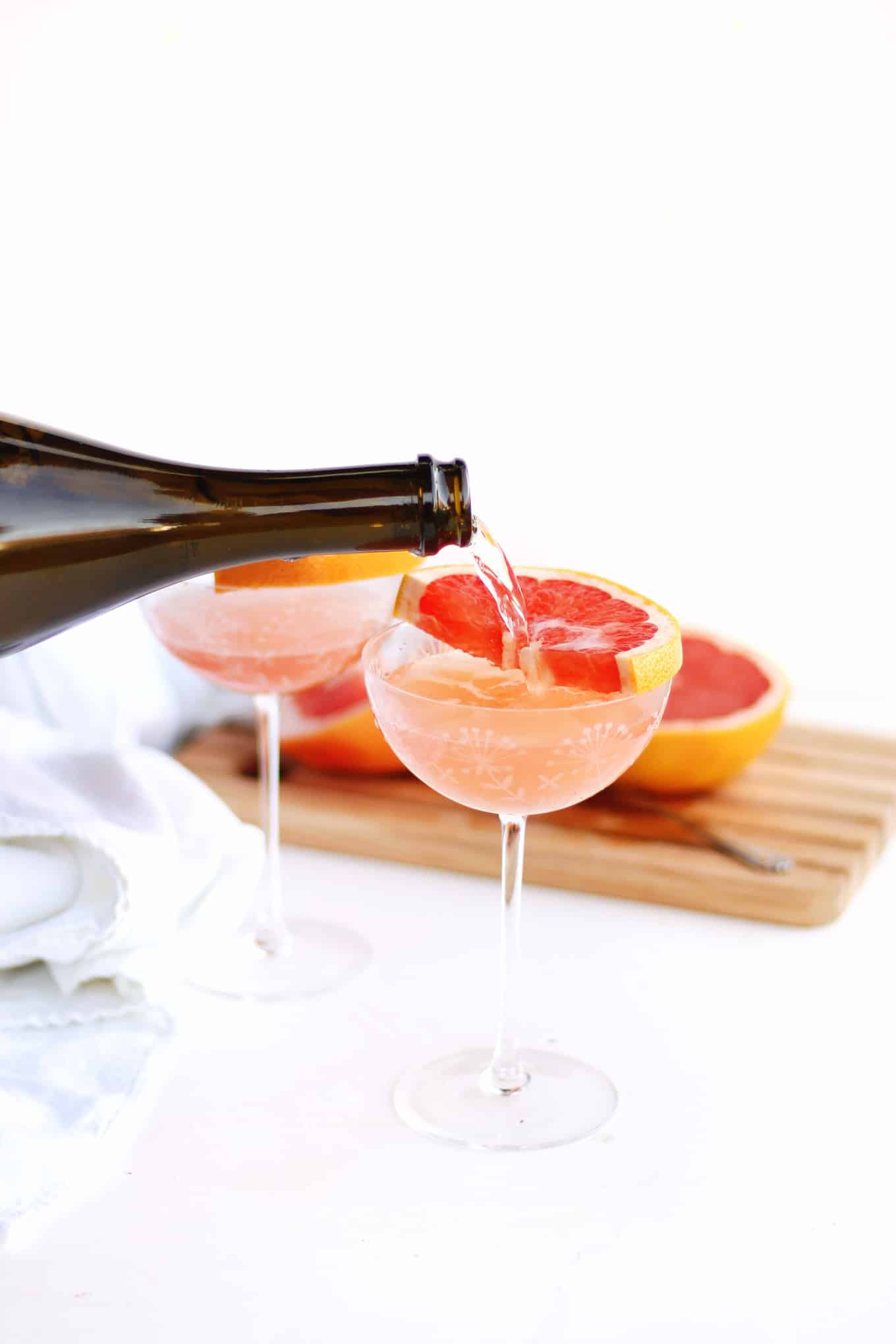 grapefruit juice and champagne pour