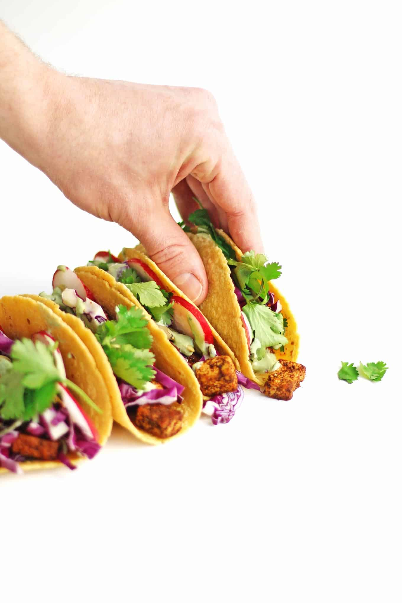 hand grabbing a vegan tofu taco