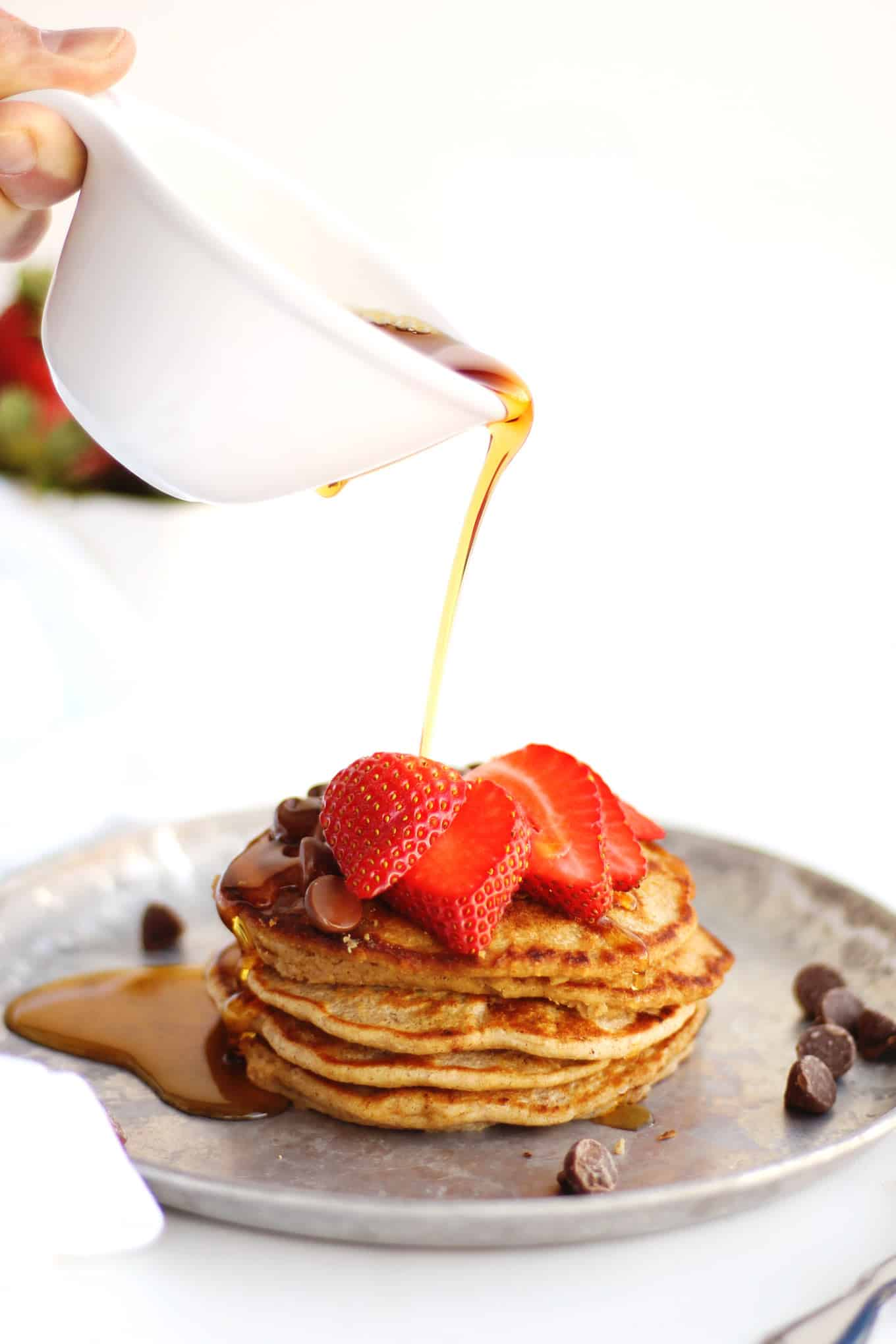 pancakes with strawberries and syrup