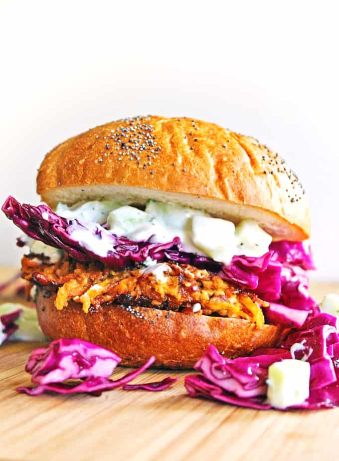 Carrot tahini quinoa veggie burger recipe! A super flavorful vegetarian burger topped with tzatziki and purple slaw. This will be your new favorite veggie loaded dinner. // Rhubarbarians