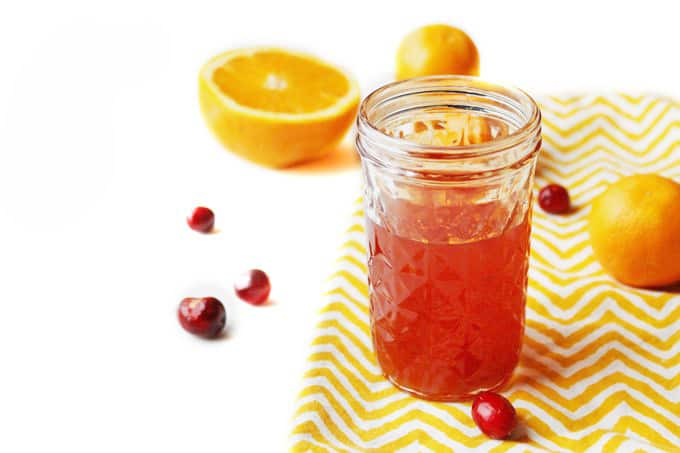 Cranberry and orange infused bourbon! Infuse bourbon, whiskey, or rye with your favorite fall flavors in just a few days. Makes the best fall cocktail and is perfect as a homemade holiday gift! // Rhubarbarians