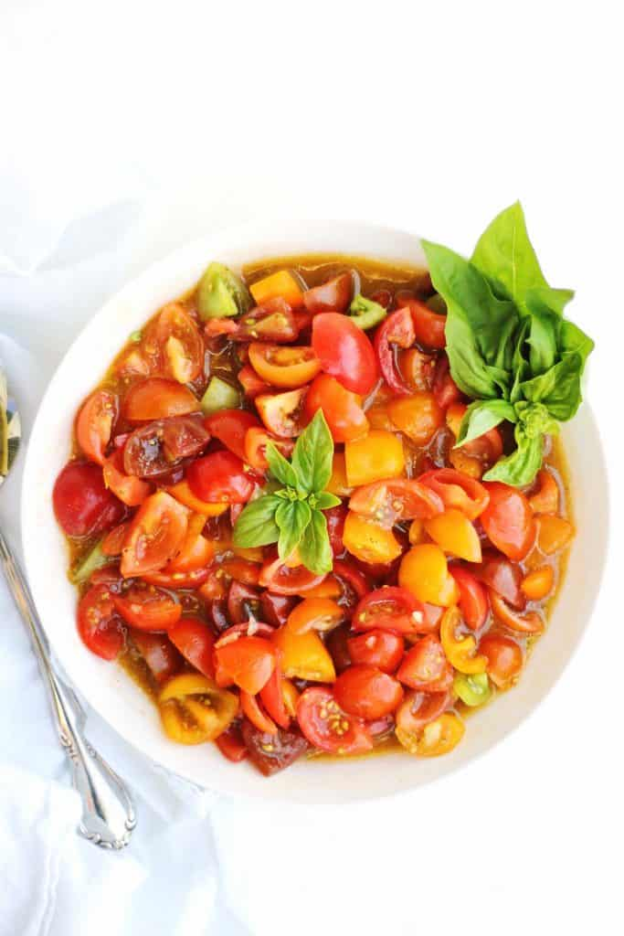 Fresh tomato sauce with basil in a white bowl