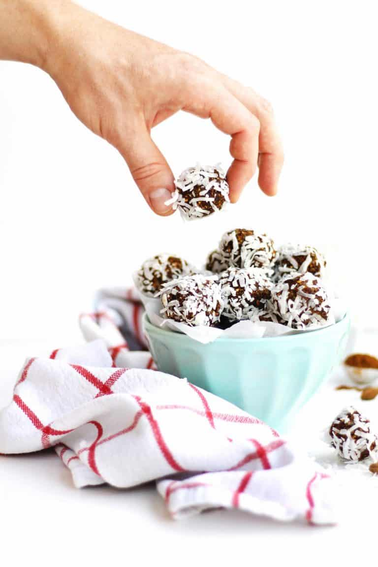 Plum and pistachio coconut bliss balls recipe! These protein packed coconut bites are the perfect quick snack or healthy treat. Vegan and gluten free. // Rhubarbarians