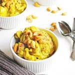Vegan cauliflower curry with potatoes and cashews recipe! This coconut curry stew is packed full of flavor and healthy ingredients! Create a warm and comforting dinner in under an hour! // Rhubarbarians //