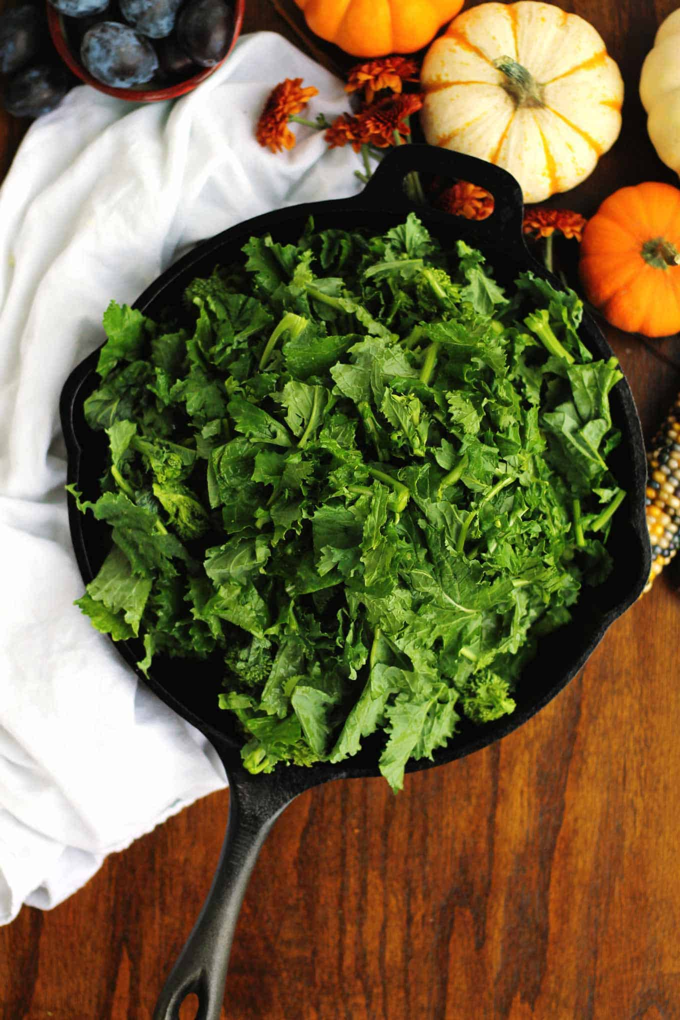 broccoli rabe and kale in a black skillet