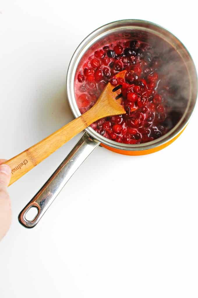 homemade cranberry sauce cooking in a pot