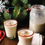 some homemade eggnog in front a christmas tree