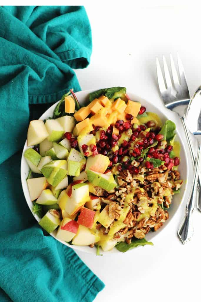 autumn apple salad in a white bowl