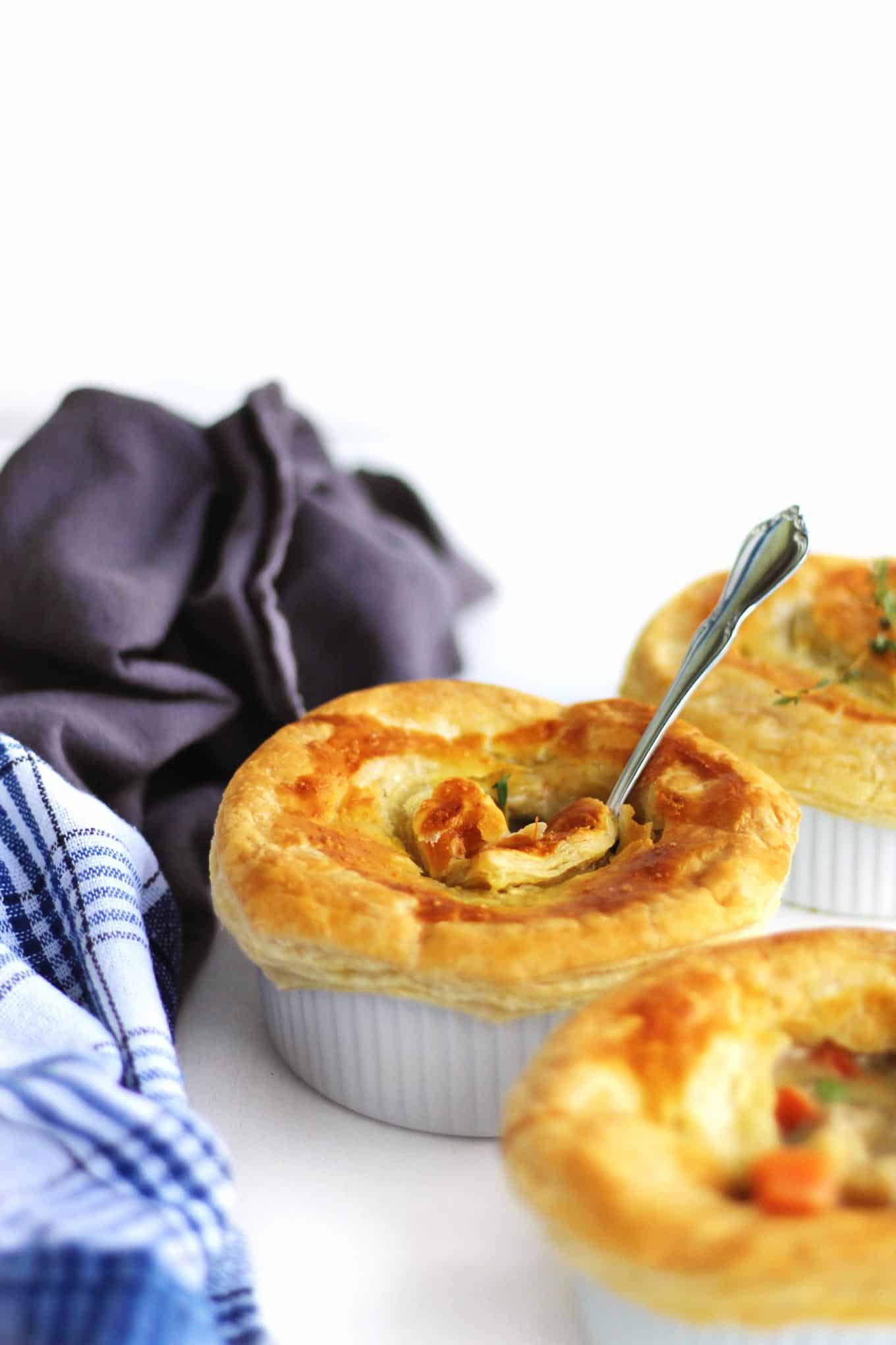 vegan chicken pot pies with a spoon