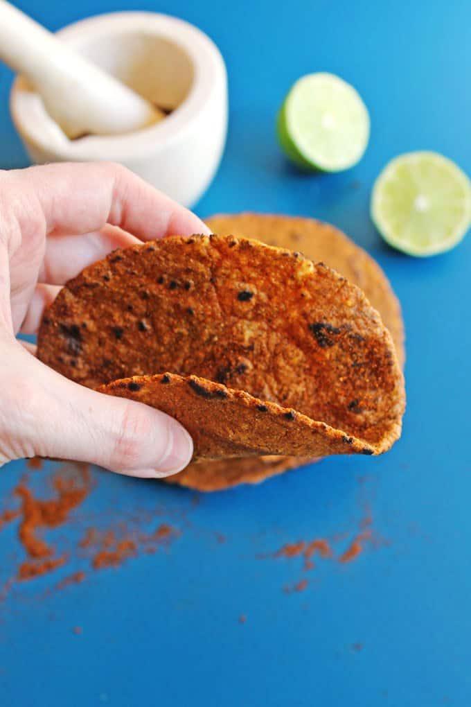 hand holding a tortilla