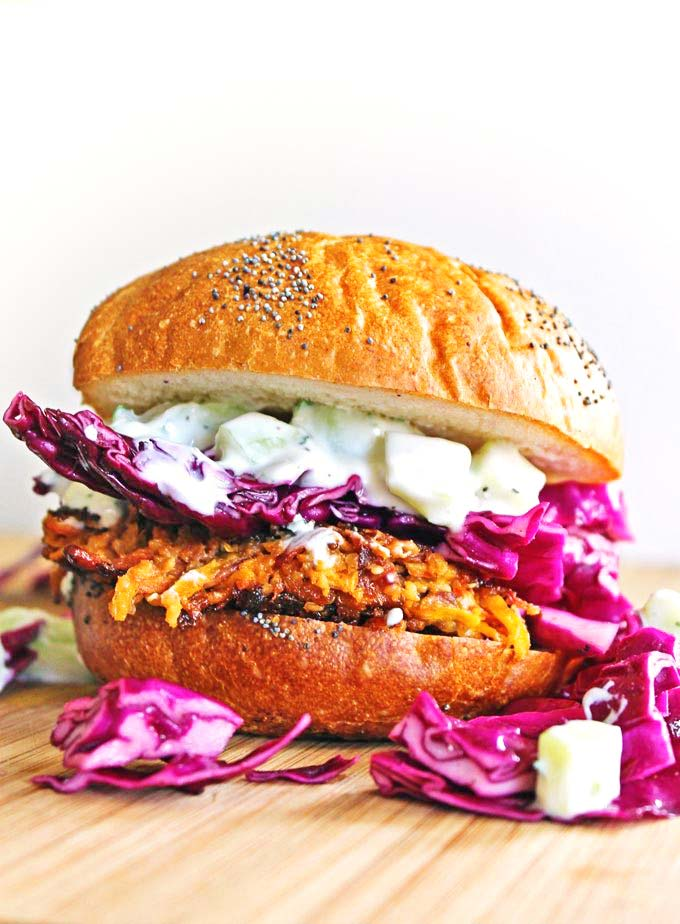 Carrot veggie burgers with purple cabbage and tzatziki close up
