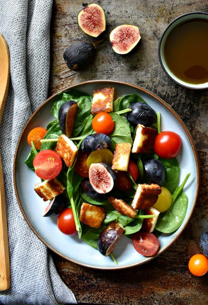Fig and halloumi salad against a weathered backdrop