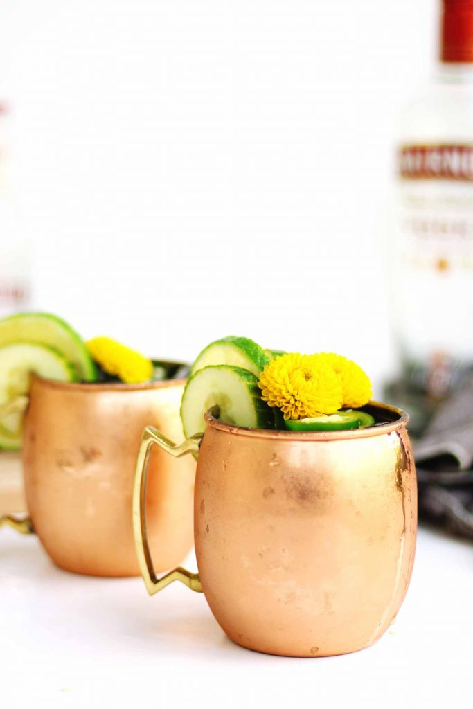 jalapeno cucumber moscow mule in a copper mug with condensation