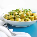 herb potato salad in a white bowl