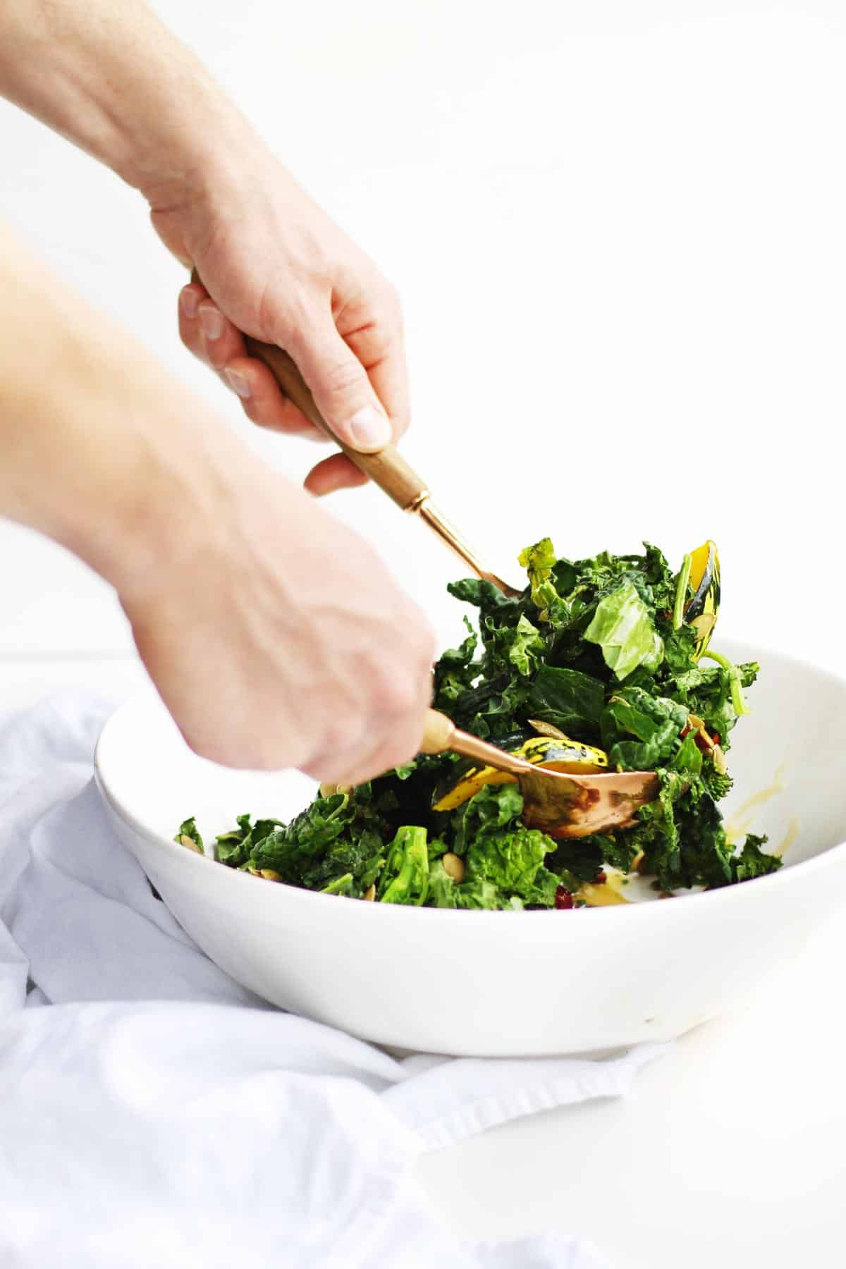 Tossing kale salad