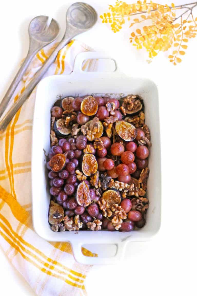 roasted grapes and figs in a white pan