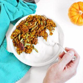 eating pumpkin granola and yogurt