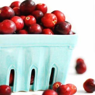 fresh cranberries in blue basket