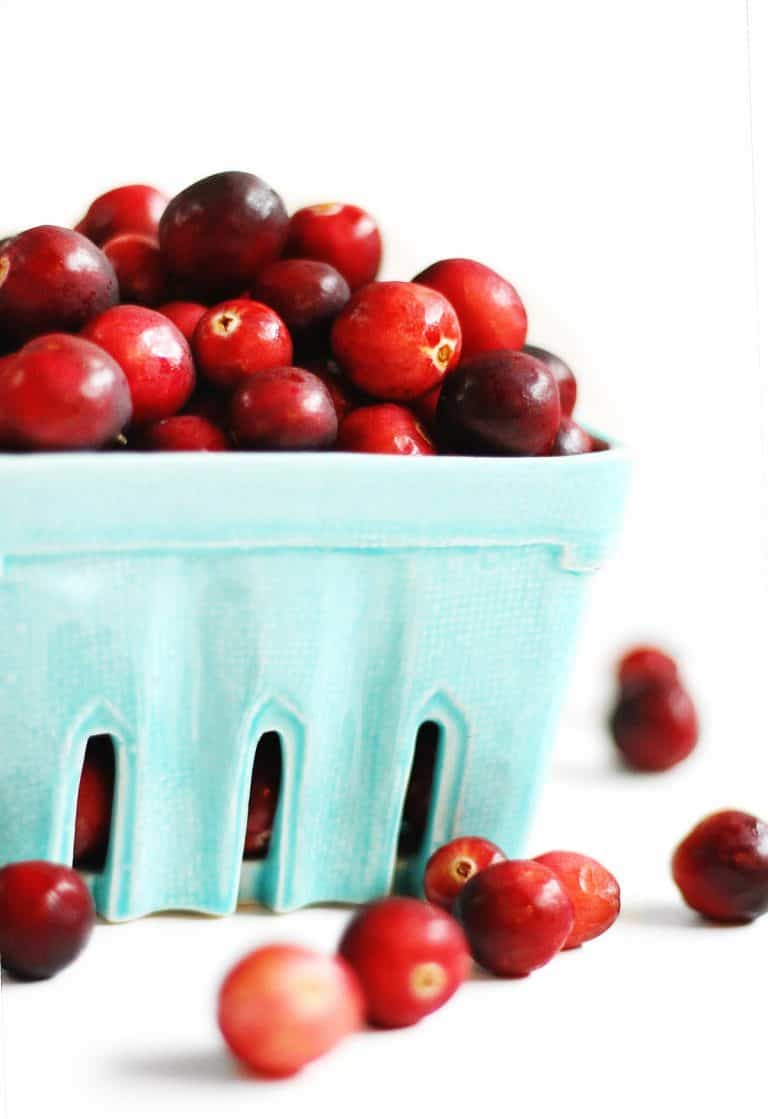 fresh cranberries in blue basket