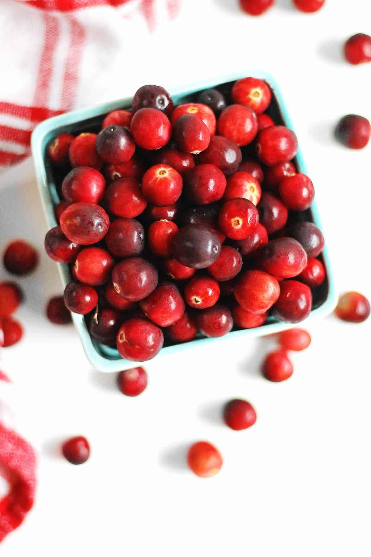 cranberries in a farmers market basket