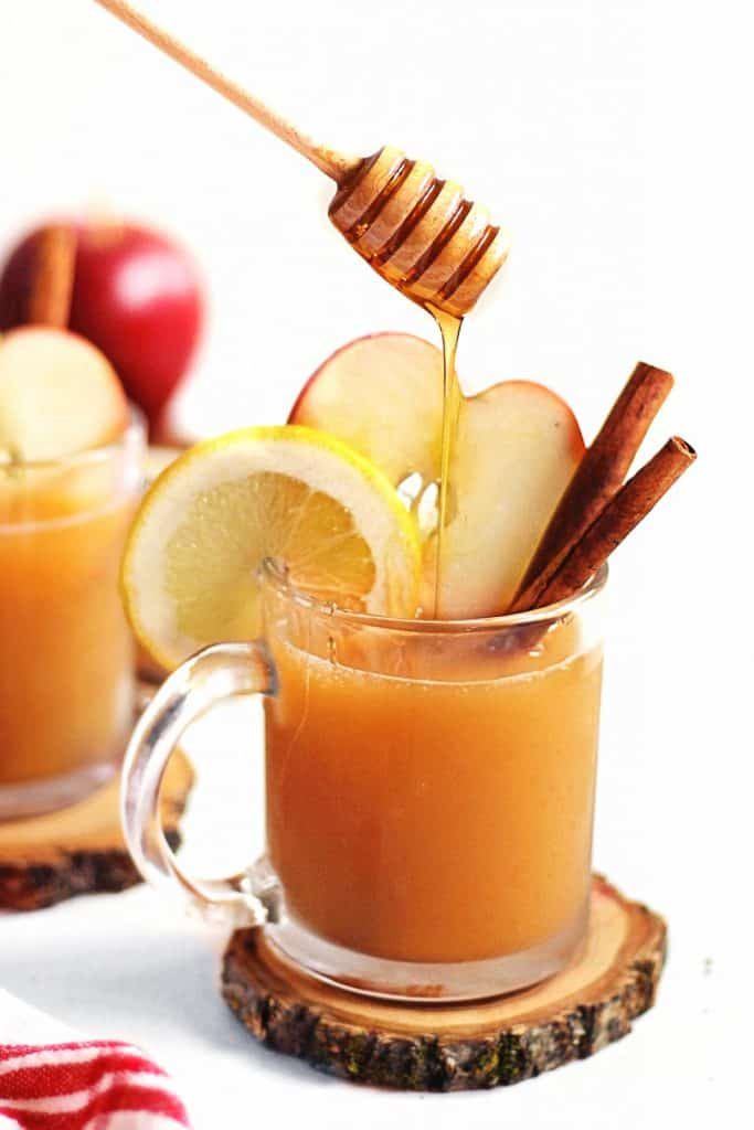 honey pouring into apple cider cocktail