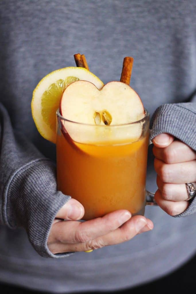 hands holding an apple toddy