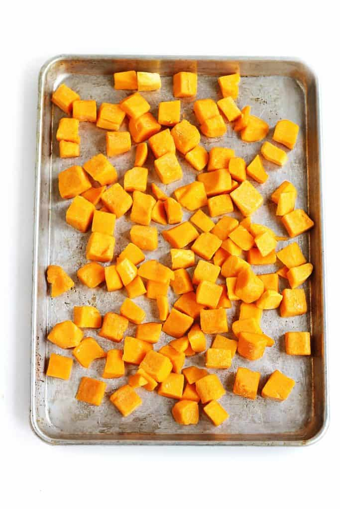 cubed squash on a sheet pan