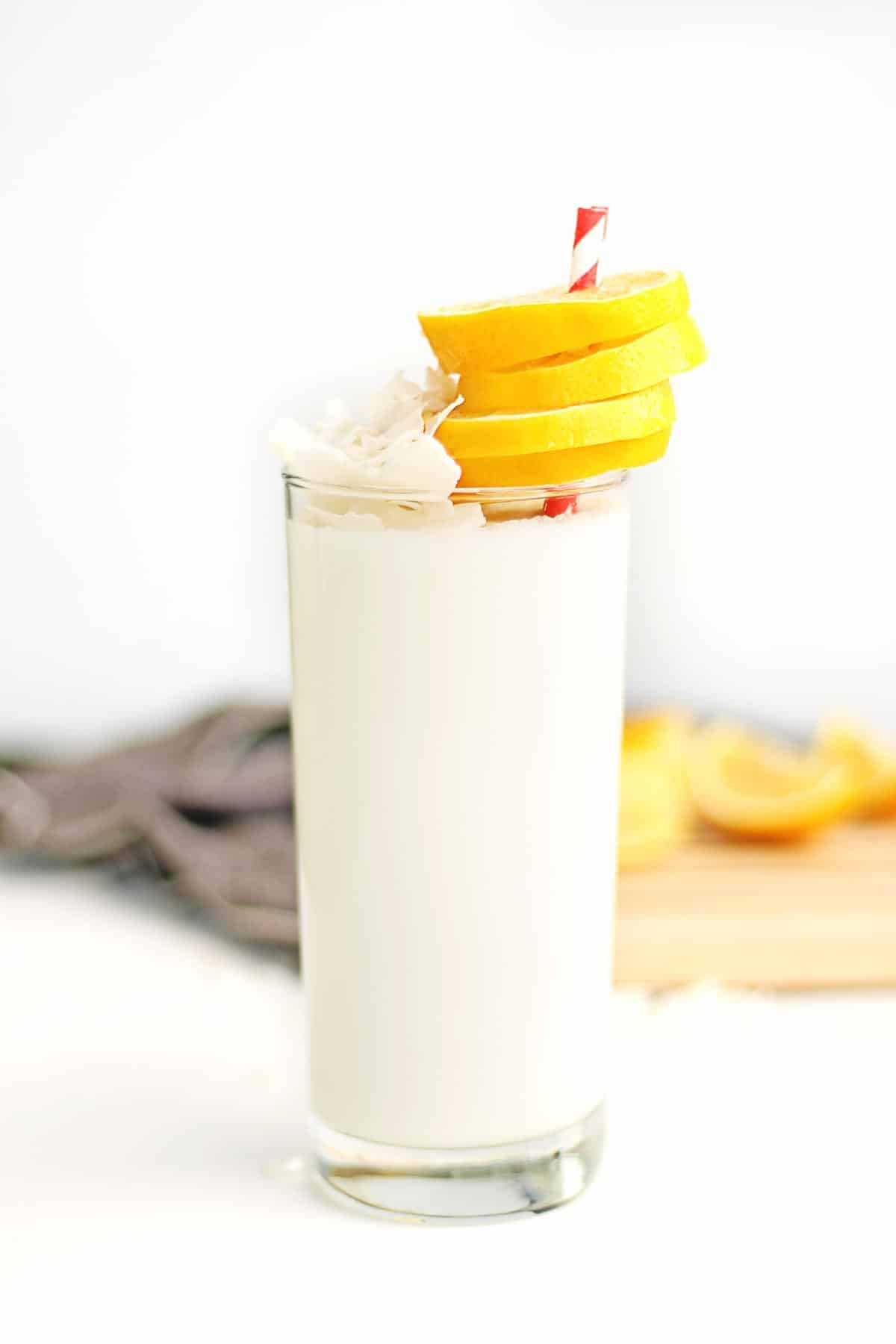 lemon coconut smoothie with slices of lemon
