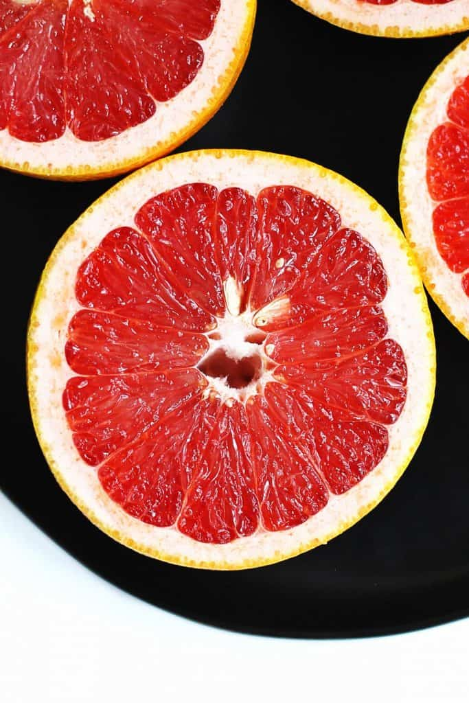 Ruby grapefruit on a black plate