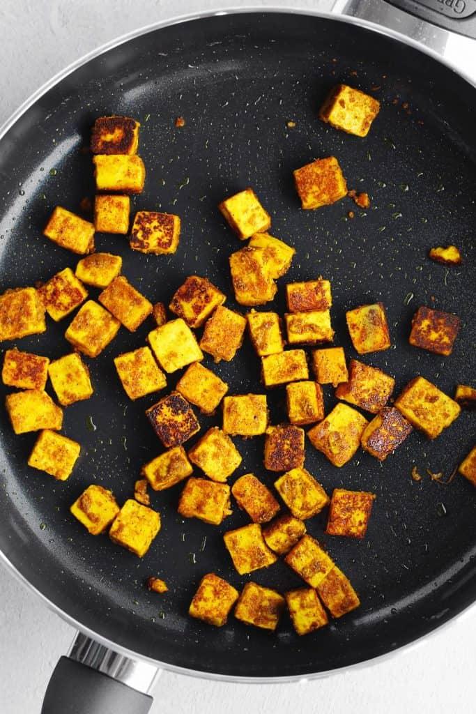 Cooking paneer in a frying pan
