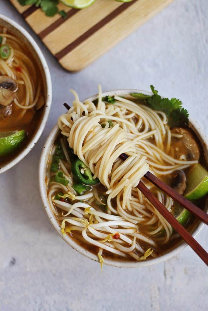 Vietnamese noodle soup on chopsticks