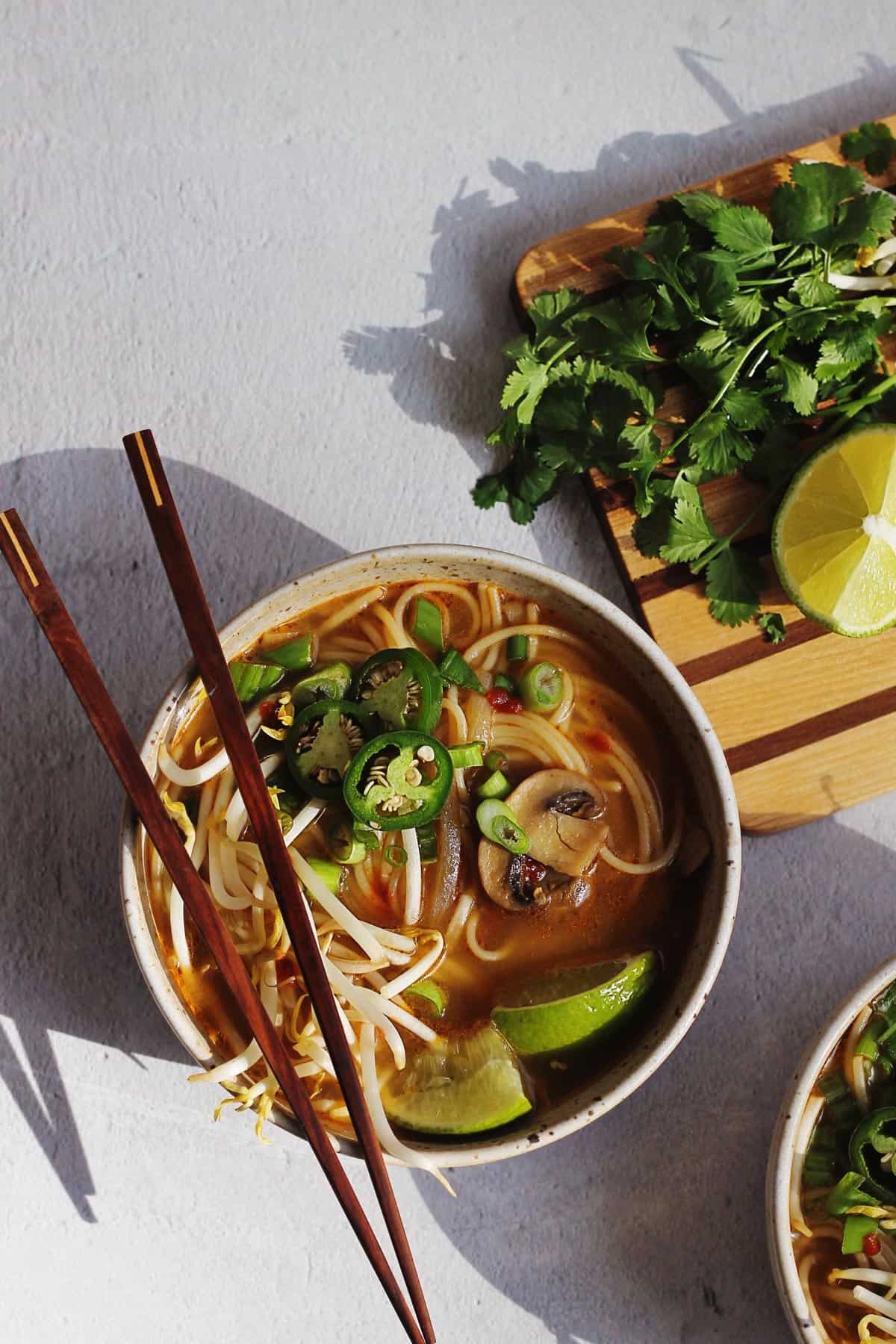 Quick and easy vegan pho with chopsticks