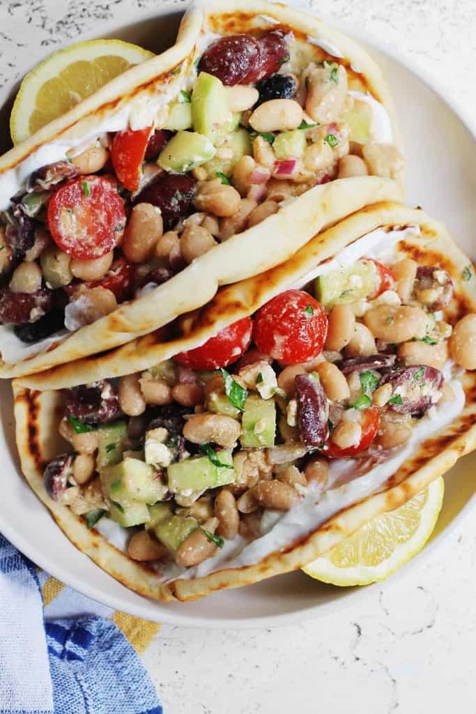 white bean greek salad in pita bread