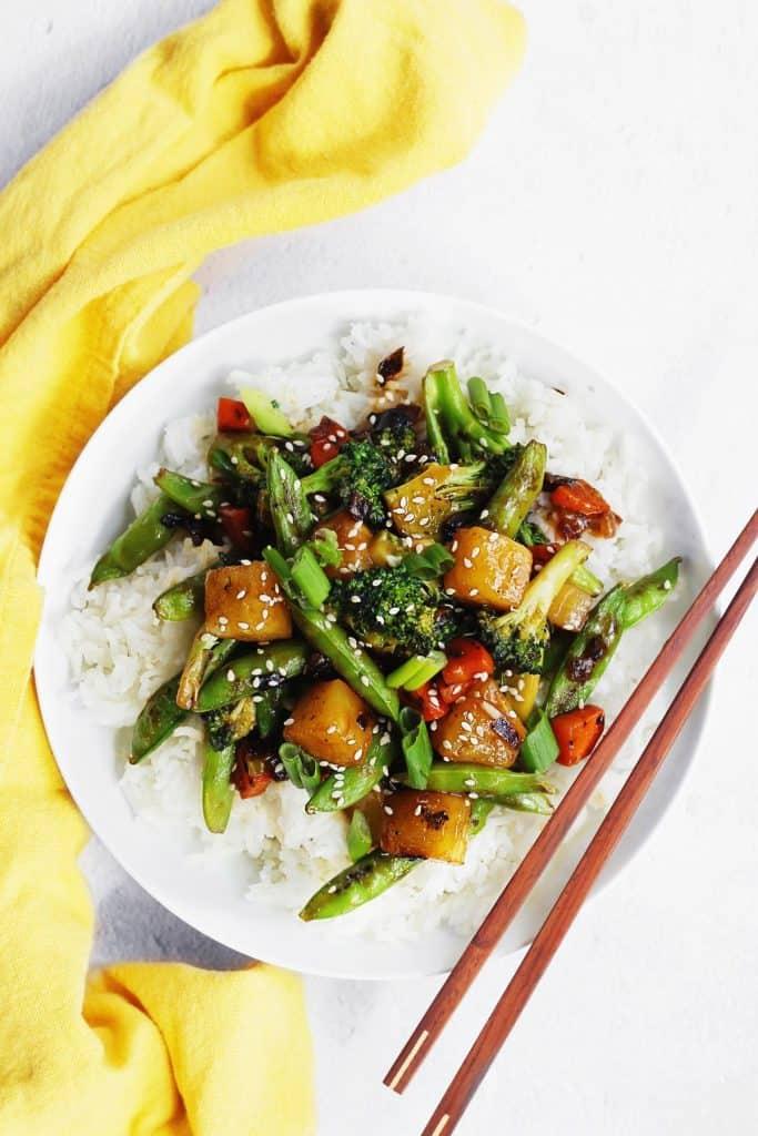 Teriyaki vegetable stir fry with rice and chopsticks