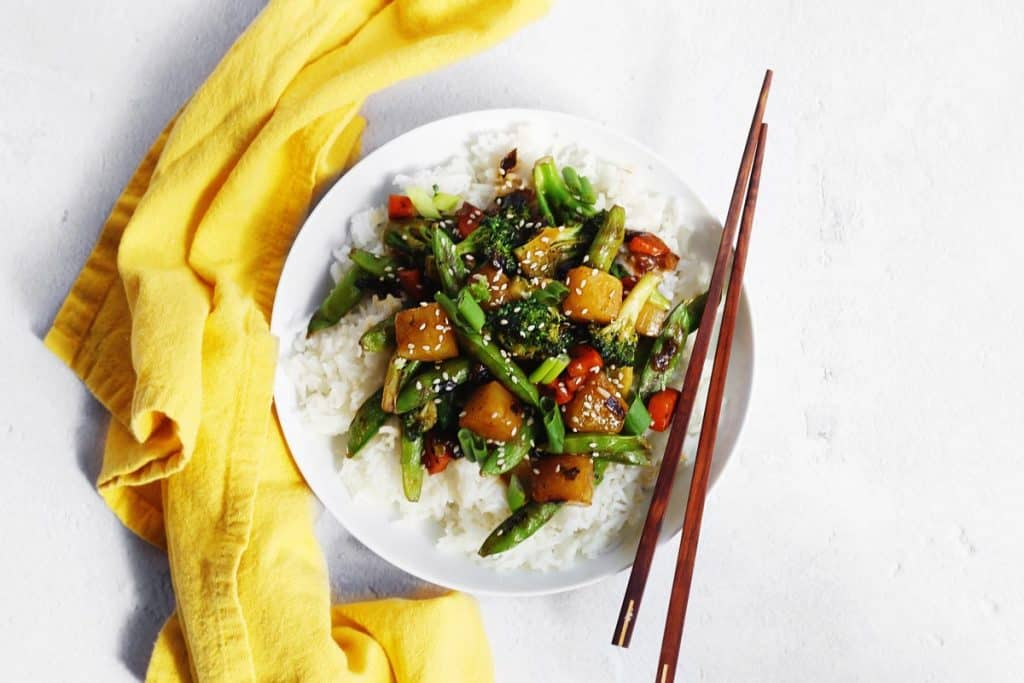 Pineapple veggie stir fry with rice and chopsticks