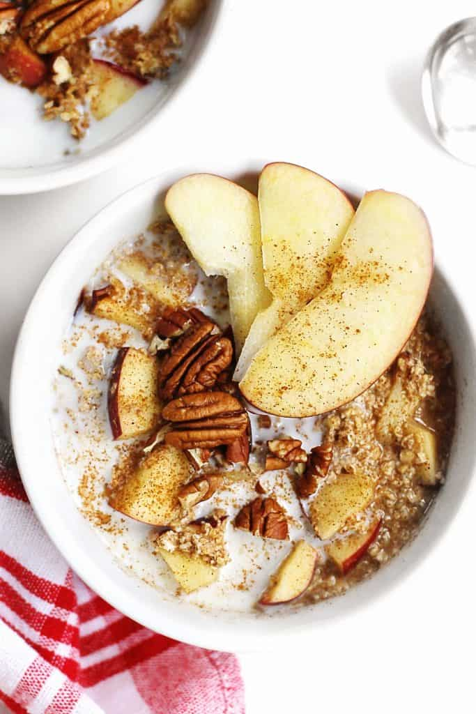 apple cinnamon pecan oatmeal in a white bowl