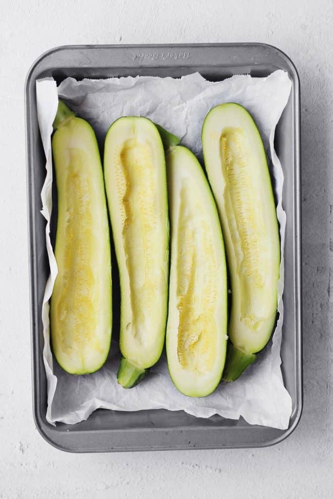 4 zucchini boats in a baking pan not stuffed