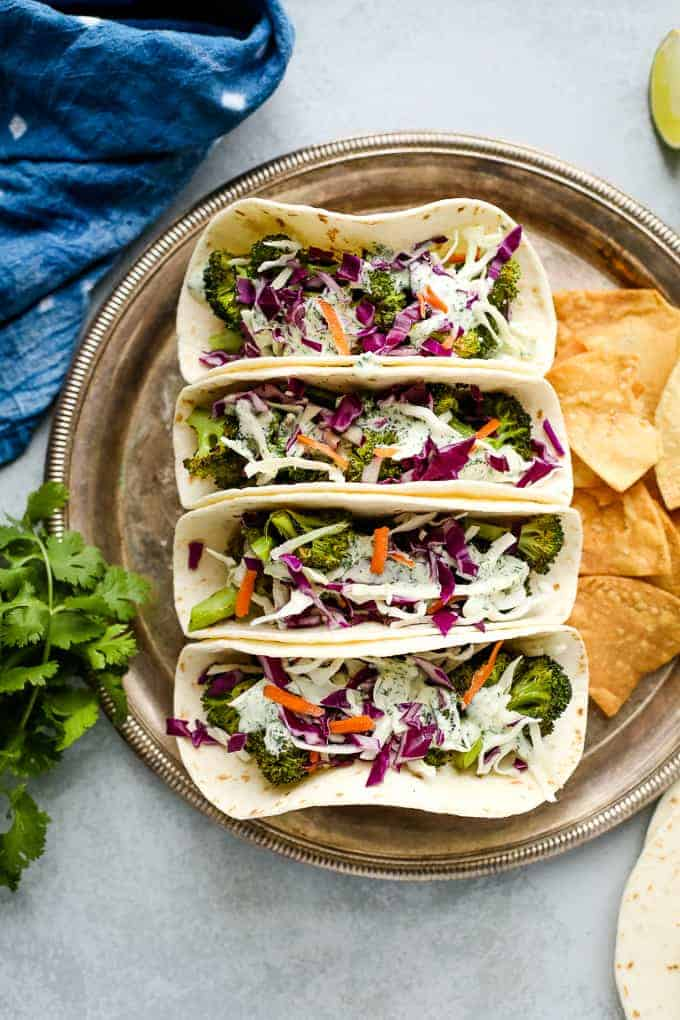 Vegan broccoli tacos with slaw and chips
