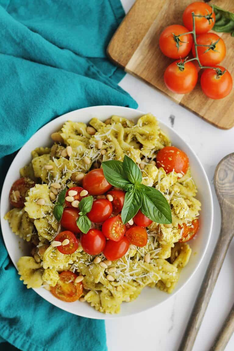 Pesto pasta salad with tomatoes and basil