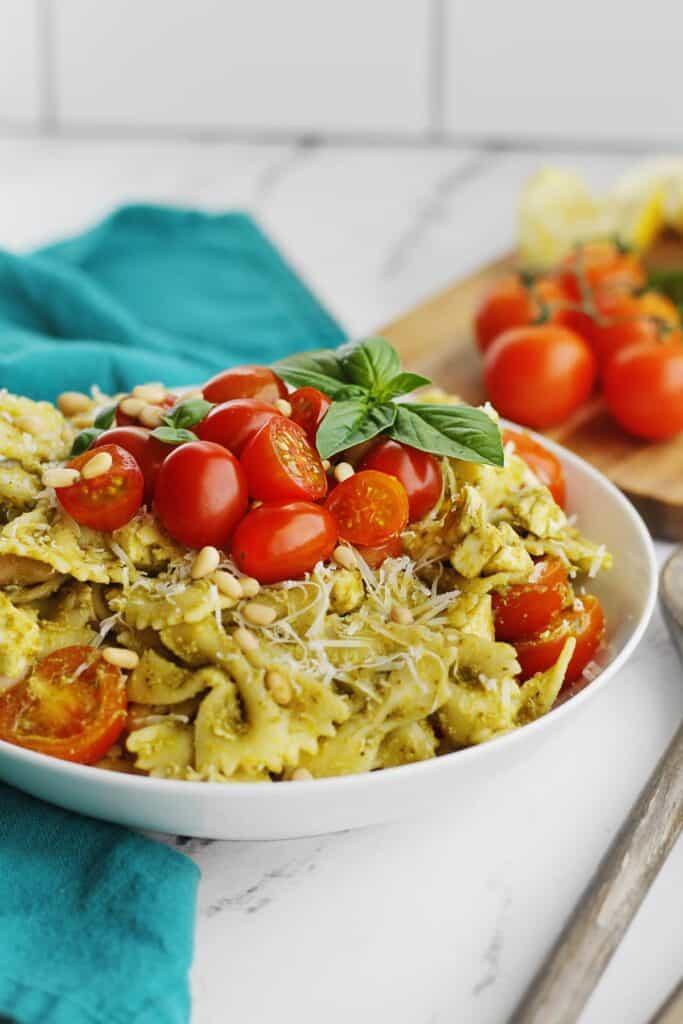 Pesto pasta salad with tomatoes and fresh basil